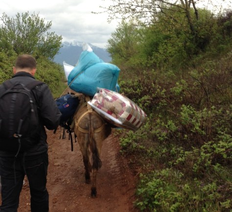 We get some help carrying our gear down to the farm!